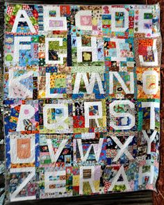 Wonky ABC I-Spy Quilt. images in each block correspond with the letter. UnRuly Letters.