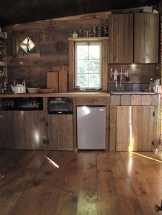 Im all about natural brick backsplash but i really like the wood planks as well. rustic kitchen