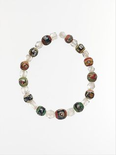 String of Roman Mosaic Glass & Rock Crystal Beads, circa 1st century A.D. The glass beads are decorated with faces or busts, either four or five to each bead, & sometimes separated by geometric or floral designs. Roman, Eastern Mediterranean.  #crystal #quartz #mineral #antiquity #jewelry #Roman