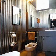 corrugated metal walled bathroom.