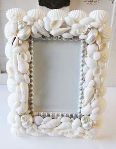 White Seashell 3.5 x 5 Picture Frame (http://www.caseashells.com/white-seashell-3-5-x-5-picture-frame/)