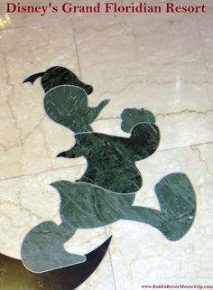 Donald Duck  inlay (small) in the marble floor in the lobby at Disney's Grand Floridian Resort.   There is a larger Donald Duck featured in another area of the lobby floor.  For more resort photos, see: http://www.buildabettermousetrip.com/disneys-grand-floridian   #DonaldDuck #GrandFloridian #Disneyworld #WDW
