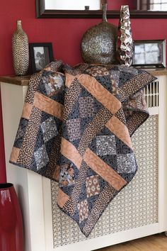 We think you'll enjoy making this #easy #quilt. Create the woven appearance by turning every other block. Quilt kit and digital pattern available! Find Earthenware Tiles in Easy Quilts Fall '14.