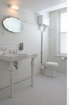 Bathroom - hex marble tiles, console sink