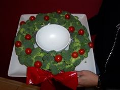 Instead of using a plastic red bow (as in the picture), you can make an edible one out of red pepper slices.