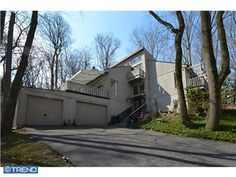 Penn Valley contemporary with multi-level private decks and indoor/outdoor hot tub on 1.18 acre wooded lot.  $639,000