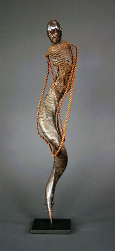 Africa | A medicine horn containter from the Para or Zigua people, Tanzania | The antelope horn body of this vessel is wrapped in natural fiber rope with a carrying strap. Carved wooden head | ca. early 20th century