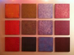 The art project we just put over our couch today!  Scrapbook pages spray glued onto 12x12 boards.