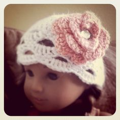 An American Girl doll cap I crocheted (my original pattern here too).