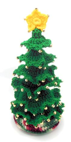"$1.99 Little Fir Christmas Tree Crochet Pattern This Little Fir Christmas Tree resembles the fir trees that are usually used for Christmas trees.  It actually has a center trunk and the ""branches"" are actually worked on the trunk after the trunk is made."