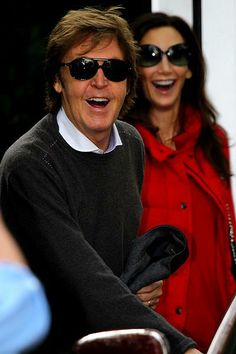 Paul McCartney and Nancy Shevelle-McCartney (mirror expressions. Nice to see him happy =]