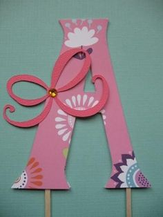 A Scrapping Style Paper Monogram Cake Topper...cute for kids birthday cake