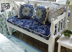 The bench cushion and side table fabrics are actually shower curtains!