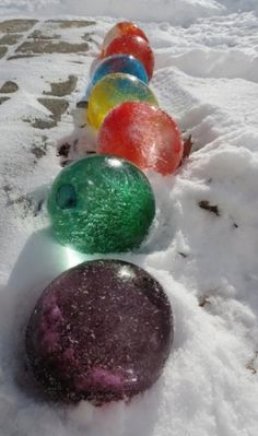 I have got to do this. Fill balloons with water and some food coloring, once frozen cut off the balloon. Use them as decoration in the winter!