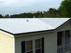 http://www.mobilehomerepairtips.com/mobilehomeroofingoptions.php has some information on the types of roofing available for your mobile home.