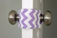 This handy little device allows you to open and close your baby's door without making noise by turning the knob.  :-)