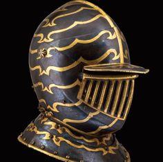 A fine Italian blued and gilt cuirassier's close helmet, early 17th century