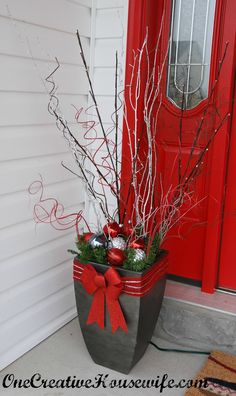 red doors, front door decor, outdoor christmas decorations, christma decor, front doors, christma planter, christmas planters, front porches, christmas door