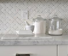 Meredith Heron Design  #CarltonCondo  Style at Home Feature  Kitchen Marble Backsplash, Marble counter