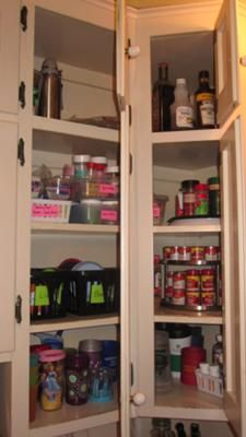 Re-orgainzed corner cabinets used for pantry items {featured on Home Storage Solutions 101}