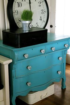 Love this paint color and the dresser - too cute!