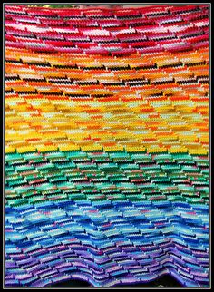 "Scrappy Rainbow Blanket    Made totally from recycled and scrapped leftover yarns!    ""A very old design my mother taught me:""  sc tbl, spike stitch every ten st, self fringing...work only on right side."
