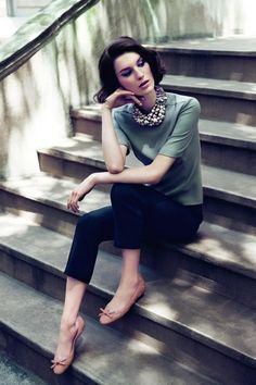 Flats, casual cropped trousers, fine knit t-shirt & statement necklace
