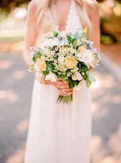 yellow wildflower bouquet, photo by Danielle Poff Photography http://ruffledblog.com/century-house-wedding #flowers #weddingbouquet