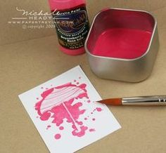 Paint and ink resist with clear embossing.
