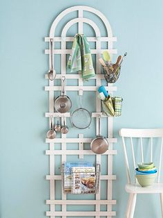 Add hooks and knobs to a garden trellis hanging on the wall for storage.  Would be good in any room.