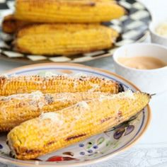 Grilled sweet corn on the cob with an all-American aioli then topped ...