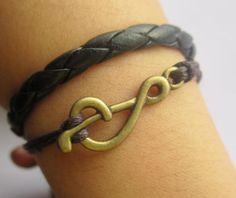 Bracelet: antique bronze music note bracelet & black leather chain