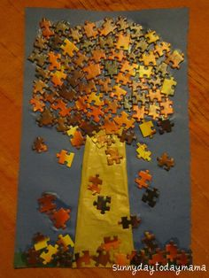 Jigsaw puzzle tree -- reuse a puzzle that's missing pieces. Pick out the pieces in fall colors to make an autumn tree. What else could be made with puzzle pieces?