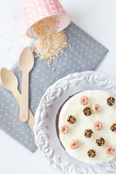 Fun for Mother's Day! Make mom a cake with donut sprinkles.