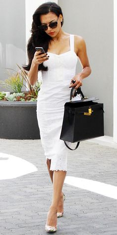 Naya Rivera pieced together a flawless summer-ready look, starting with her white eyelet Rebecca Minkoff bustier dress and her black Hermes bag, right down to her rose floral python Stuart Weitzman pumps. #InStyle