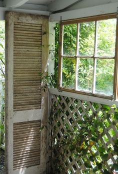 love this old window and shutter on the porch