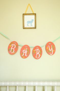 hand-painted floral baby banner (available in several different colors)