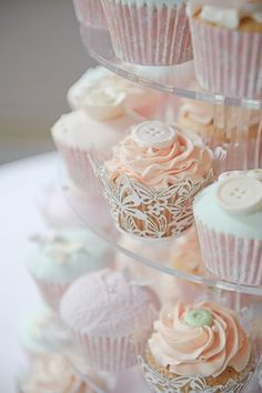 pretty cupcakes with edible buttons on top