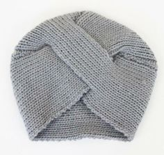 Grab the award for trend setter with this vintage inspired gray knit turban.
