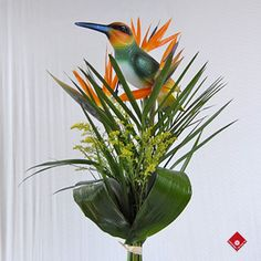 9. Floral Arrangements #modcloth #wedding  Put a bird on it!