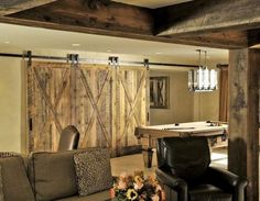 Room divider barn doors with X brace . This website sells all of the hardware needed for sliding doors.