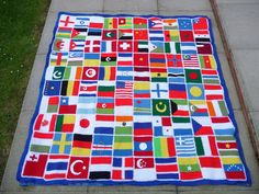 Made by Sue from the blog 'Sunshine International Blankets of Love' ~ this afghan was made using squares that people sent to  her from all over the U.S. Each square represents a different country or theme of the Olympics.