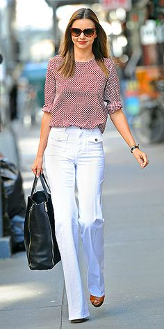 Miranda Kerr #streetstyle #flare #highwasted #white #jeans #blouse #cateyes
