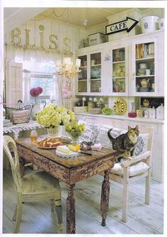 gorgeous kitchen - if only I could keep white chairs white . . .