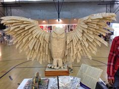 Life-sized owl made out of a copy of THE WAY OF KINGs.