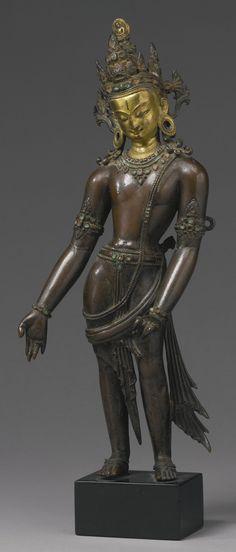 Partially Gilt Copper Alloy Figure of Avalokiteshvara Padmapani, Nepal, 14th Century, 13 3/4  in. (34.9 cm) high.