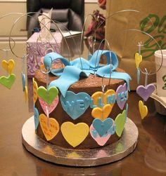 Farewell from the heart - the hearts around the cake have messages on them
