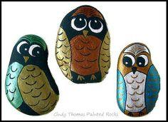 Metallic owls painted rocks