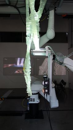 Robotic arms at SCI-Arc use UV light build 3D objects.