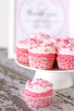 Free breast cancer awareness printables (in the background) and beautiful pink velvet cupcakes - Help Whip Cancer